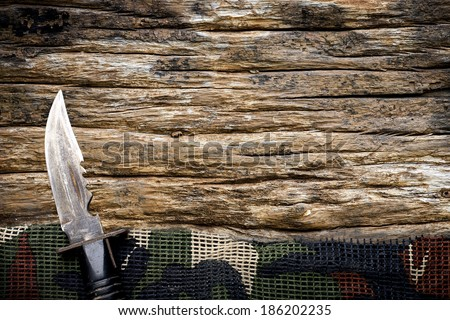 Element of military background on wooden table. - stock photo