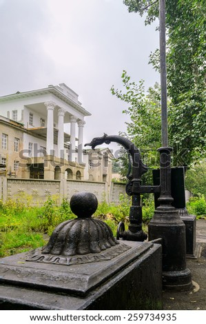 """Element of the old cast-iron fountain in the background of the manor Demidov's """"White House"""" in Kishtim - stock photo"""