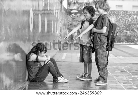 Elementary Age Bullying in Schoolyard. - stock photo