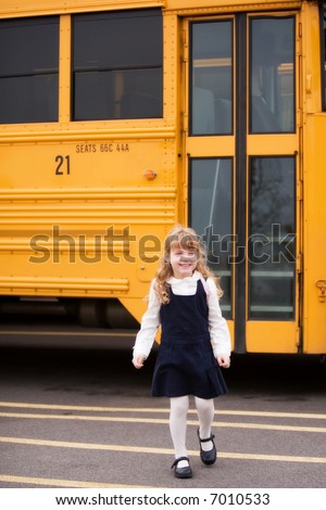 Elementary girl leaving the school bus.