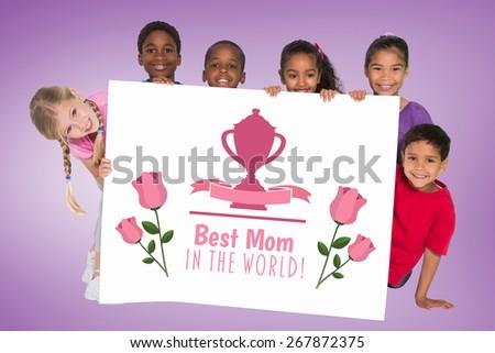 Elementary pupils showing card against purple vignette - stock photo