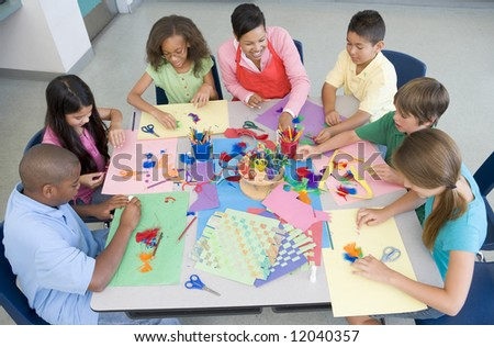 Elementary school art lesson from above - stock photo