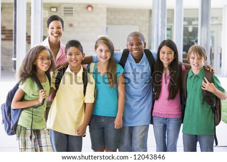 Elementary school class with teacher outside - stock photo