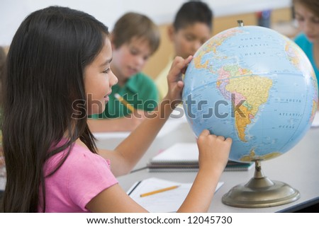 Elementary school geography class with globe - stock photo