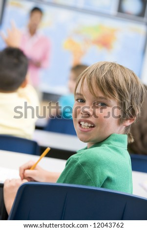 Elementary school pupil in geography class - stock photo