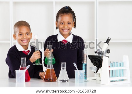 elementary school students in science lab - stock photo