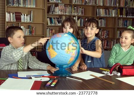 Elementary school students studying - stock photo