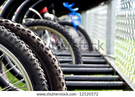 Elementary school yard bicycle rack with shallow focus - stock photo