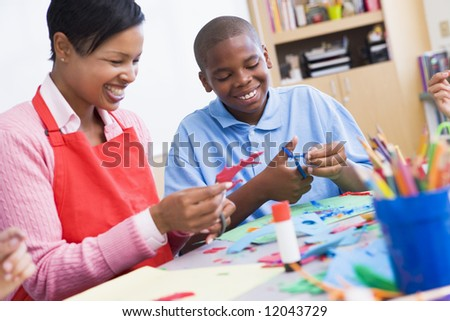 Elementary schoolart class with teacher - stock photo