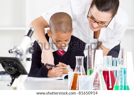 elementary science teacher and student in lab