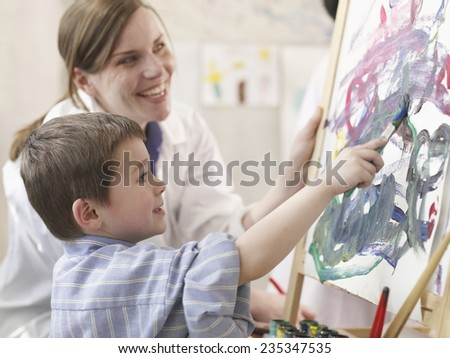 Elementary Student and Teacher in Art Class - stock photo