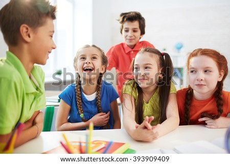 Elementary students talking together at the table