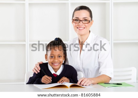 elementary teacher and student portrait - stock photo