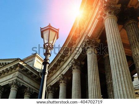Elements of architectural ensemble of Kazan Cathedral in Saint Petersburg, Russia - colonnade and metal lantern under shining sunset light  - stock photo