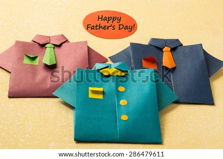 Elements of design for Father's day: a shirt made from paper in origami technique, the inscription: Happy Father's Day - stock photo