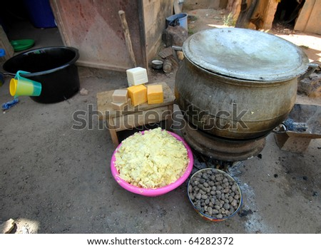 elements of shea butter, nuts, cream and soap - stock photo