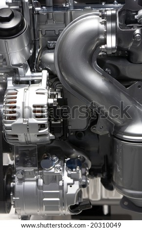 Elements of the new modern automobile engine shown at an auto exhibition - stock photo