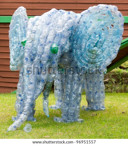 Elephant made from plastic bottles. Concept of how to make useful and beautiful things from garbage - stock photo