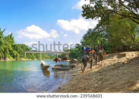 Elephant ride riverside in Thailand - stock photo