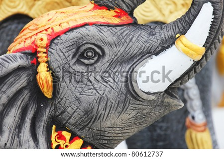Elephant sculpture in a Buddhist shrine, Thailand. - stock photo