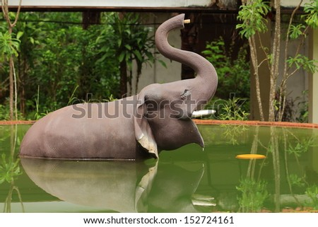 Elephant Sculpture in Water. - stock photo