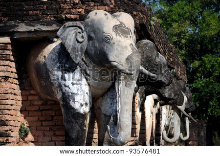 "elephant statue around pagoda at temple "" Wat Chang Lom"" , Sukhothai, Thailand"