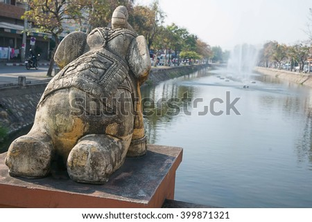 Elephant statue at chiangmai downtown canal - stock photo