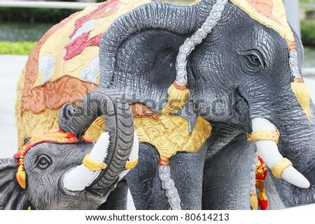 Elephant statue next to a shrine, Thailand. - stock photo