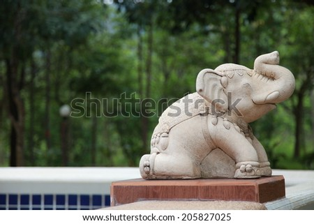 elephant statue with pool - stock photo