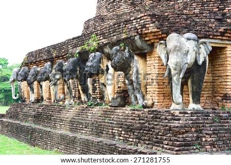 Elephant statues around Wat Chang Lom pagoda, Sukhothai, Thailand - stock photo