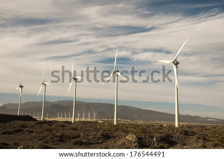 Eletric Power Generator Wind Turbine over a Cloudy Sky - stock photo