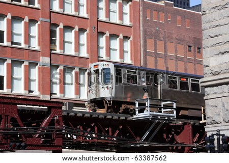 Elevated commuter train in Chicago. The El.  Chicago's public transportation system. - stock photo