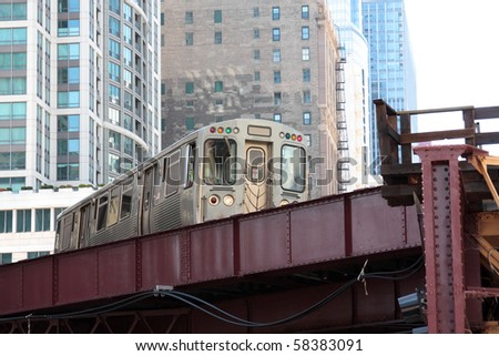 Elevated commuter train in the city, Chicago, Illinois - stock photo