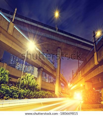 elevated express way Under view of the city overpass at night, HongKong Asia China  - stock photo