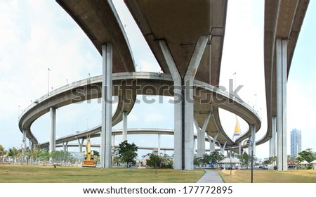 Elevated expressway. The curve of suspension bridge Large elevated traffic highway in Bangkok, Thailand. - stock photo