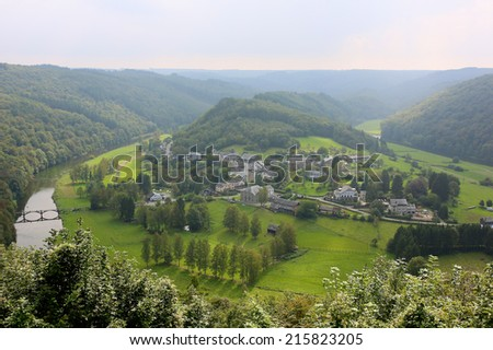 Elevated view from famous panoramic viewpoint of beautiful small Frahan village lying inside the bend of the river Semois from the city of Rochehaut, Wallonia, Ardennes, Belgium - stock photo