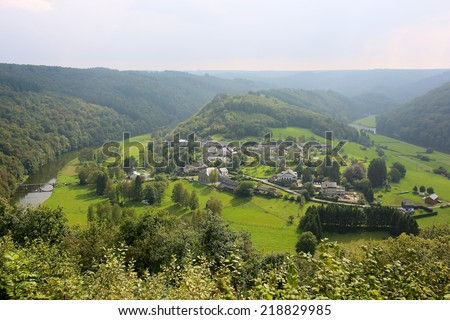 Elevated view from famous panoramic viewpoint of beautiful small Frahan village lying inside the bend of the river Semois from the city of Rochehaut, Wallonia, Ardennes, Belgium