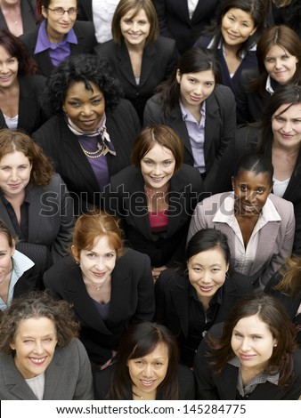 Elevated view of a group of smiling multiethnic businesswomen - stock photo