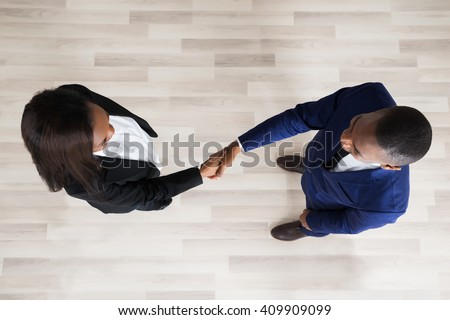 Elevated View Of Business Man And Woman Handshaking - stock photo
