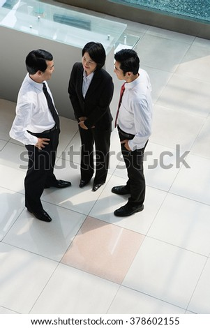 Elevated view of Chinese businesspeople - stock photo