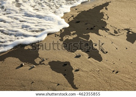 elevated view of conceptual world map on beach. Furnished NASA flat world map image used for this image.
