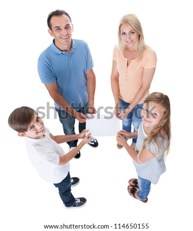 Elevated View Of Family With Two Children Holding Blank Paper Isolated On White Background - stock photo