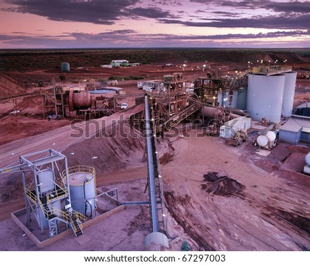 Elevated view of Gold Mine processing plant just before Sunrise - stock photo