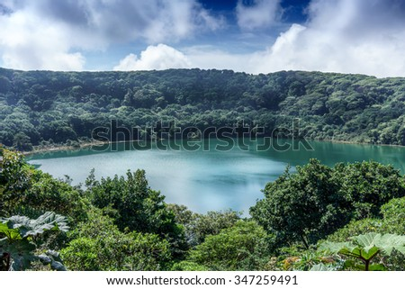 Elevated view of lake surrounding by forest, Costa Rica - stock photo