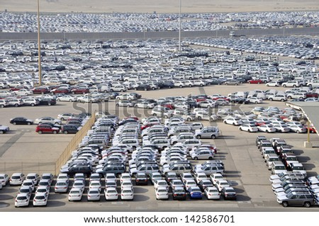 Elevated view of large dockside storage area for new cars at Abu Dhabi United Arab Emirates Asia - stock photo