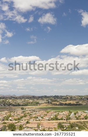 Elevated View of New Contemporary Suburban Neighborhood and Majestic Clouds. - stock photo