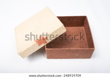 Elevated view of open empty gift box isolated on white background. - stock photo