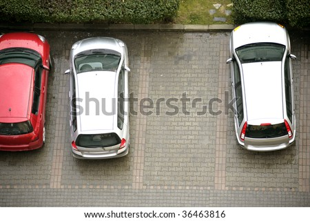 elevated view of parked cars in parking lot - stock photo