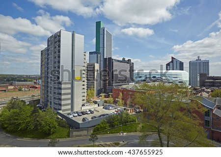 Elevated view of skyscrapers, hotels and arena in the North of Leeds under blue skies