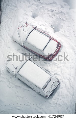 elevated view of snow covered cars in parking lot - stock photo